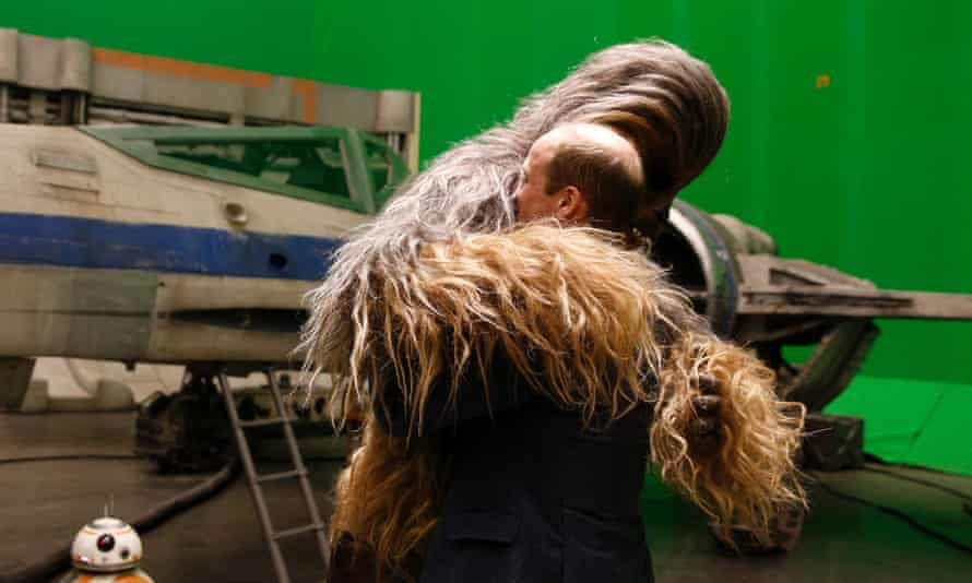 Prince William gets a hug from Chewbacca.
