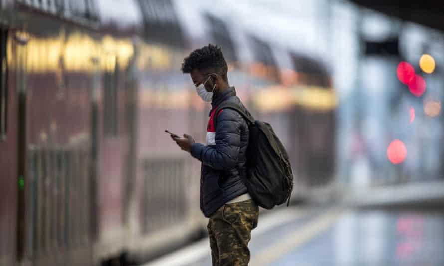 A man waits for a train in Frankfurt
