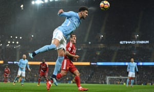 Manchester City defender Kyle Walker heads the ball away during their win over Watford.
