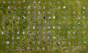 An aerial view shows people gathered inside painted circles on the grass encouraging social distancing at Dolores Park in San Francisco, California on May 22, 2020.