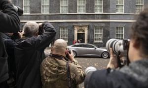 Theresa May leaves Downing Street.