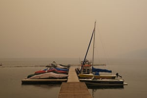 Boats at Fallen Leaf Lake. Schools were closed for a second day in Reno, about 60 miles (100km) from the fire.
