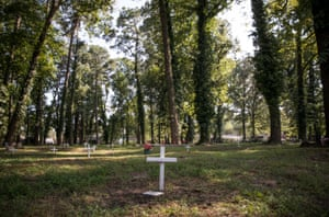 The Tucker family cemetery has more than 104 markers, with burials dating to the 1800s. The white crosses are unmarked graves which were identified by ground penetrating radar.