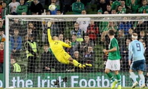 Darren Randolph makes one of a number of important saves as the Republic of Ireland held on for a draw.