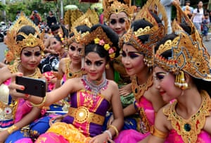 Balinese girls pose during New Year celebrations in Denpasar, Bali