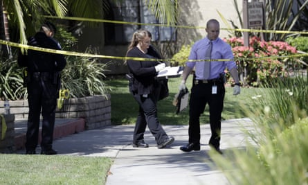 Police investigate the scene where two people were stabbed to death on Thursday in Garden Grove, California.