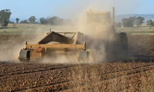 A farmer ploughs his dusty field in Sheldon, California, as a severe drought continues to affect the state.