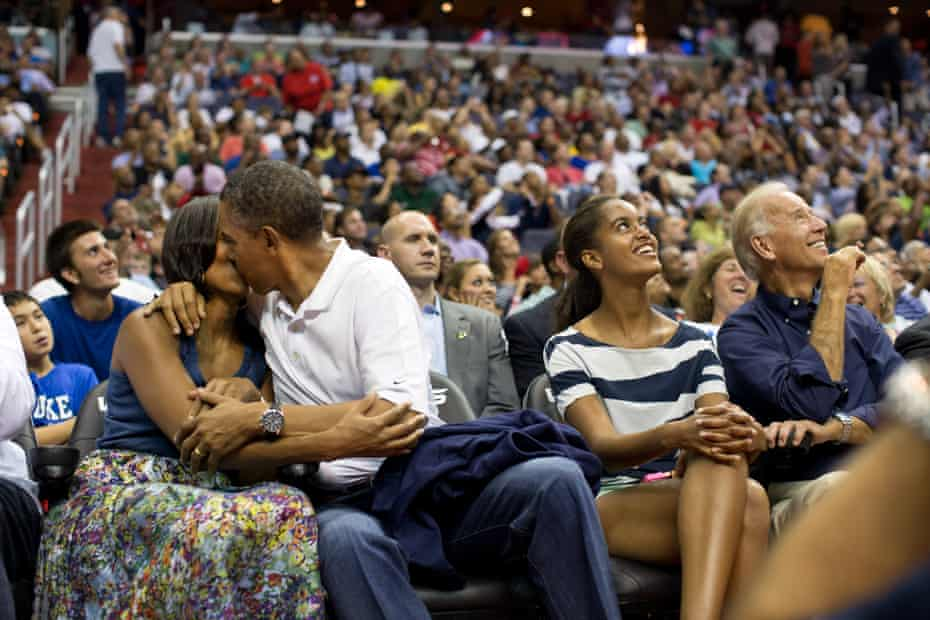 From left: Michelle Obama, Barack Obama, Malia Obama and Joe Biden at a basketball game in Washington DC in 2012.