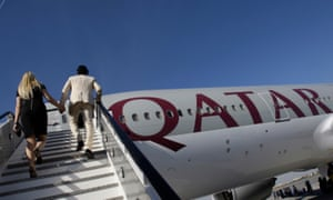 Passengers board a Qatar Airways' Boeing 777-200LR, which may be used for the new Auckland and Santiago routes.