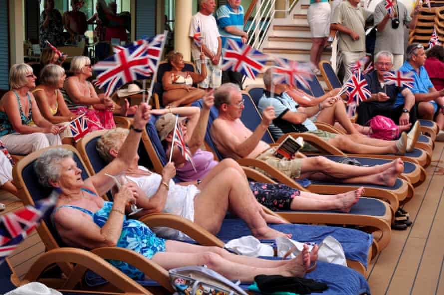 Cruise passengers at a 'sail away' party as they leave the UK.