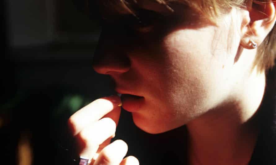 Teenage girl taking pill