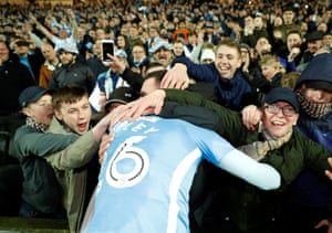Coventry's Jordan Shipley celebrates with fans at the end of the match.
