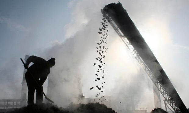 A labourer works at a coal factory in Baicheng county in northwest China. The country's coal production fell in 2014.