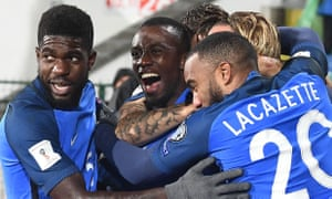 France's midfielder Blaise Matuidi celebrates with teammates after scoring his team's first goal.