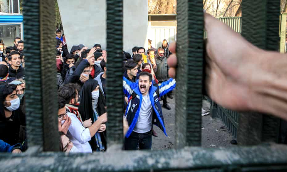 People gather to protest over the high cost of living in Tehran, Iran.