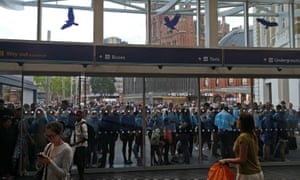 People wait outside of King's Cross station in London during the power cut
