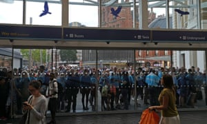 People wait outside King's Cross station in London on the day of the blackout