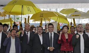 Occupy Central leaders, from right, Shiu Ka Chun, Tanya Chan, Chan Kin Man, Benny Tai, Chu Yiu Ming and Lee Wing Tat shout slogans before entering a court in Hong Kong.