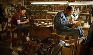 Workers in a shoemakers' studio, Portugal