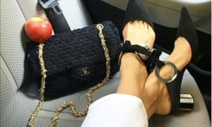 The Eva Chen pose: nice pair of shoes, nice bag, piece of fruit in the back of a cab.