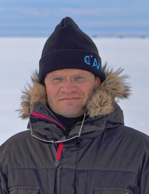 markus rex standing in coat and hat with a snowy horizon behind him