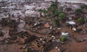Homes lay in ruins after two dams burst in November 2015, flooding a small town in Minas Gerais state, Brazil.