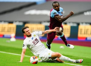 Michail Antonio of West Ham rides the tackle of Kevin Long of Burnley