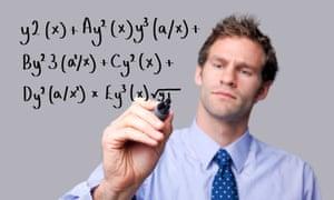 Teacher writing equations on a glass screen