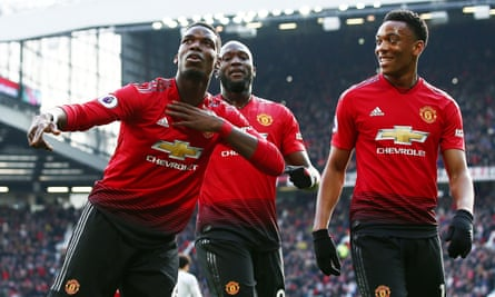 Paul Pogba (left) celebrates after the first of his two successful penalties against West Ham United at Old Trafford.
