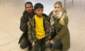 Rahman Mahafuzer with his wife, Izabela, and six-year-old son, Abdullahil, at Heathrow airport.