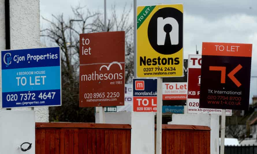 Estate agents' boards outside property on Hendon Way, London
