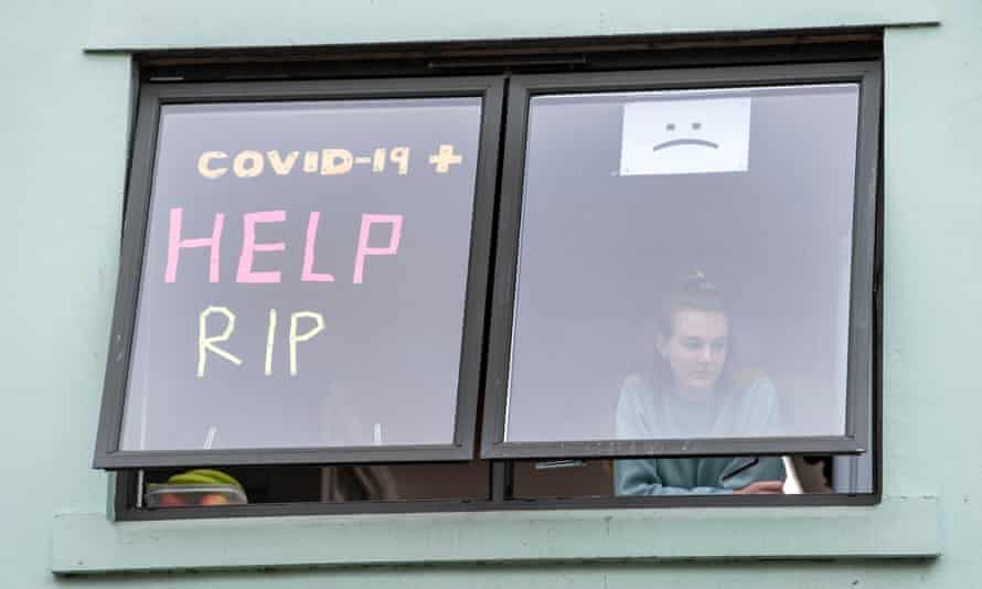 Student at window that says 'Covid-19 Help RIP'