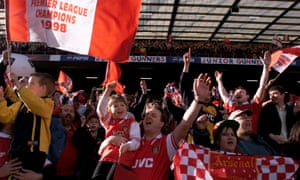 Arsenal supporters celebrate the club's Premier League title triumph in May 1998 - the first of the Arsène Wenger era