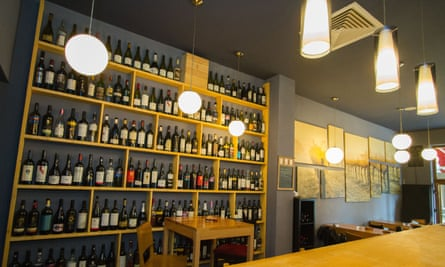 Shelves of bottles in Abel's Wine Bar, Bucharest, Romania