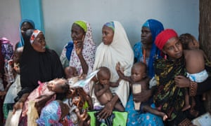 Mothers and their children waiting for a checkup at a health facility in Maiduguri, north-east Nigeria.