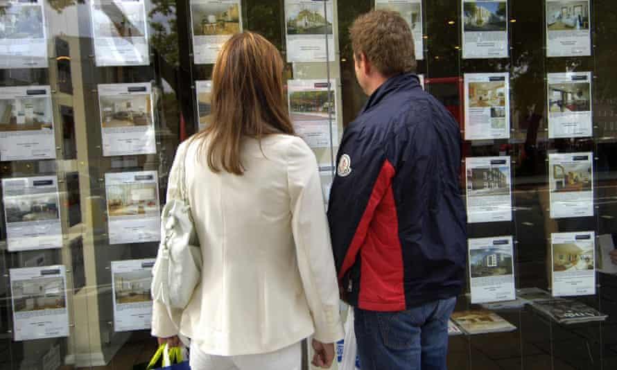 couple outside estate agency