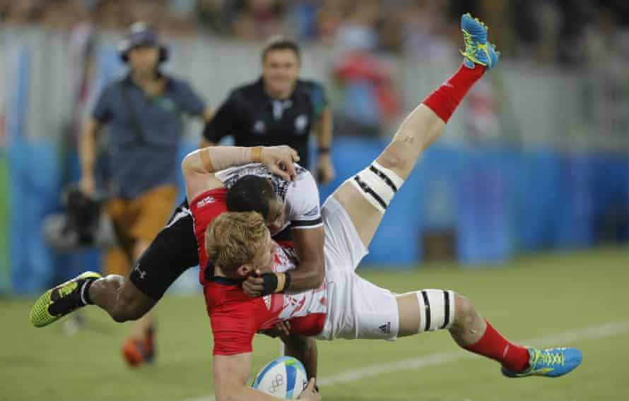 Britain's Sam Cross is tackled by Fiji's Osea Kolinisau in the rugby sevens final at Deodoro during day six of the 2016 Olympics in Rio de Janiero on August 11th 2016 in Brazil (Photo by Tom Jenkins).