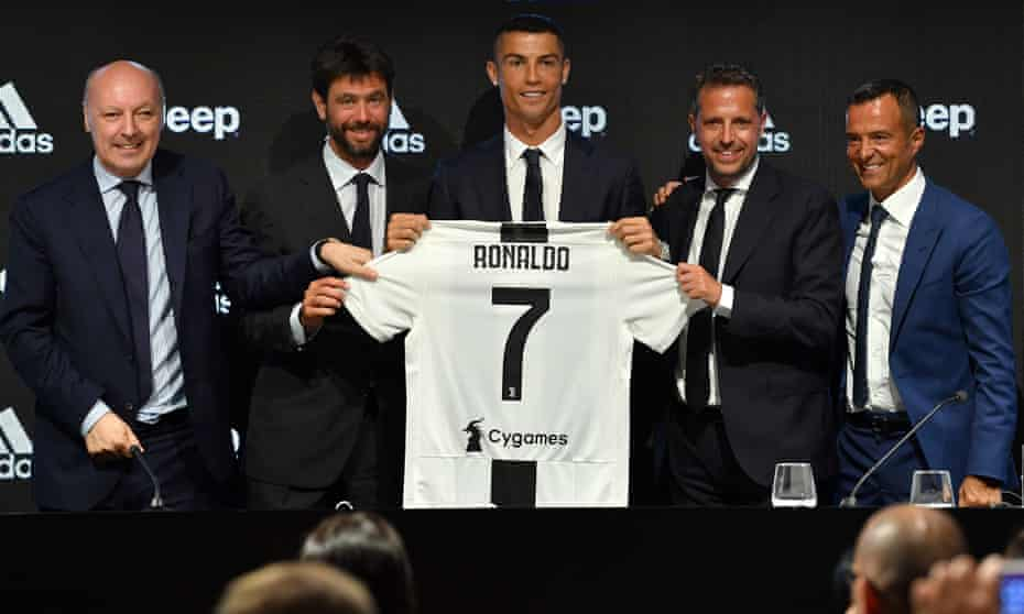 Fabio Paratici (second right) enjoys the signing of Cristiano Ronaldo for Juventus in 2018.