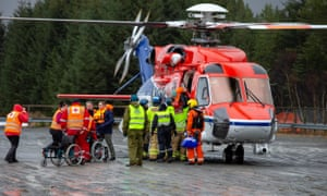 Passengers are helped out of a rescue helicopter after being rescued from cruise ship Viking Sky in Hustadvika.