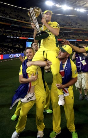 Australia's captain Michael Clarke is carried on the shoulders of team-mates David Warner, left, and Aaron Finch as they parade the Cricket World Cup trophy around the MCG.