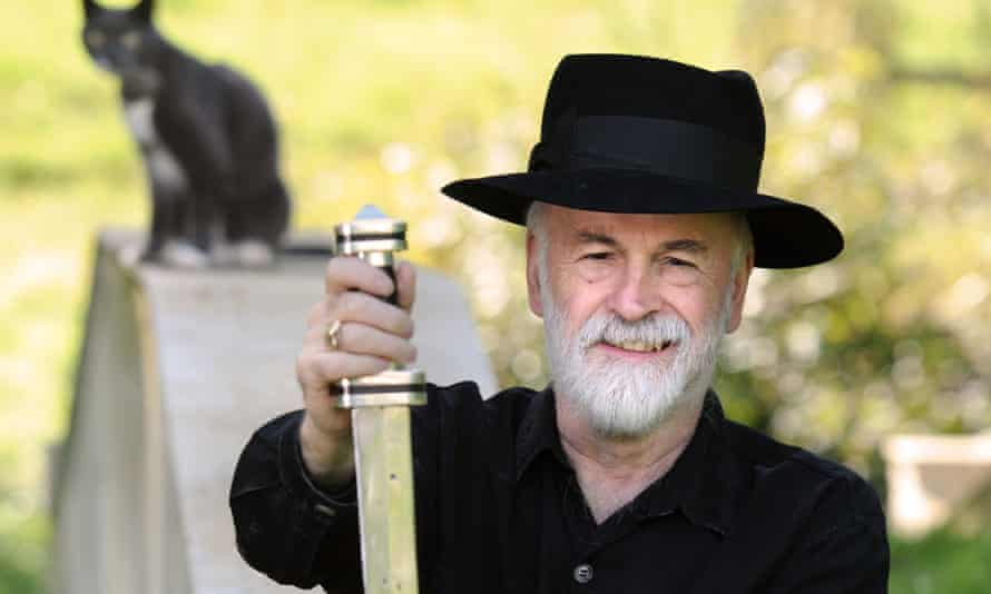 Terry Pratchett with a sword he forged from his own iron ore.