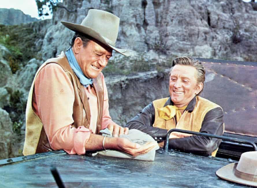 Douglas (right) with John Wayne in the 1967 film The War Wagon.