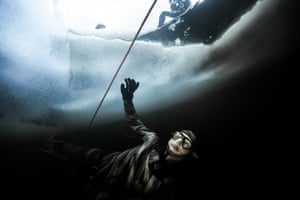 A diver under the ice with a guide rope