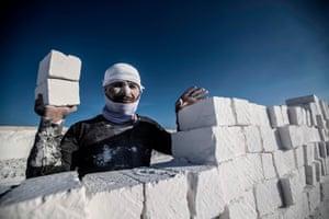 A man stacking bricks