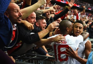 Jesse Lingard, right, celebrates with his team-mate Ashley Young in front of the United fans after scoring United's second goal.