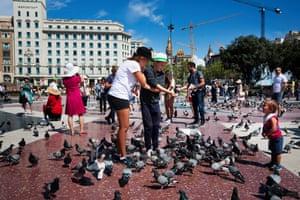 Feeding the pigeons on Plaza Catalunya.