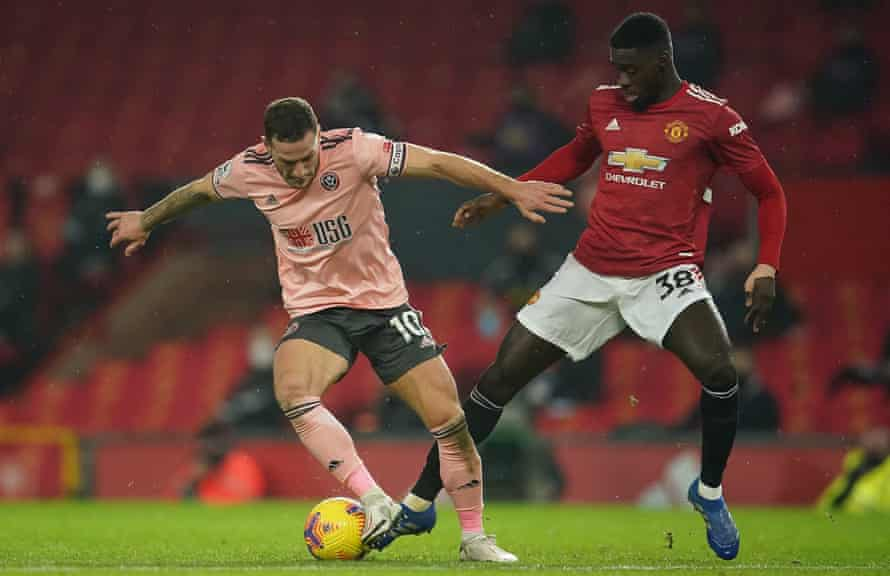 Axel Tuanzebe battles with Sheffield United's Billy Sharp.