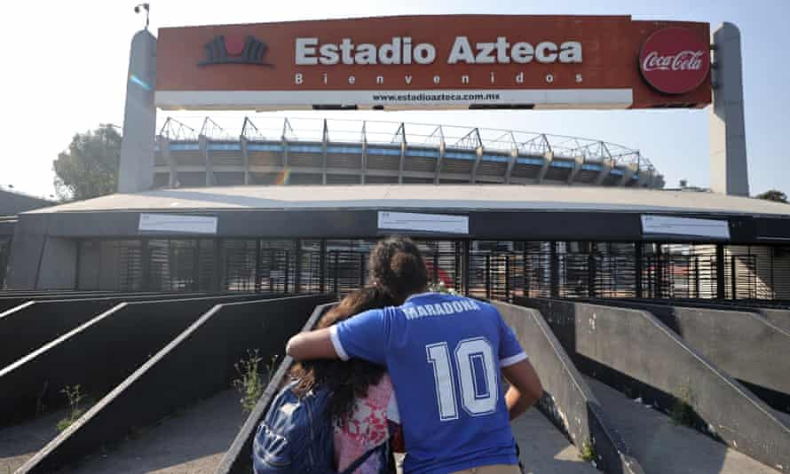 Two fans outside the Estadio Azteca, scene of Maradona's greatest triumph.
