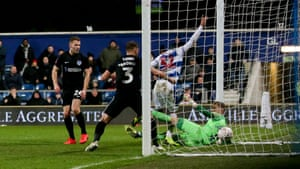 Nahki Wells bunldes in QPR's opening goal of their win against Portsmouth.
