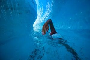 Endurance swimmer Lewis Pugh swims under an Antarctic ice sheet.